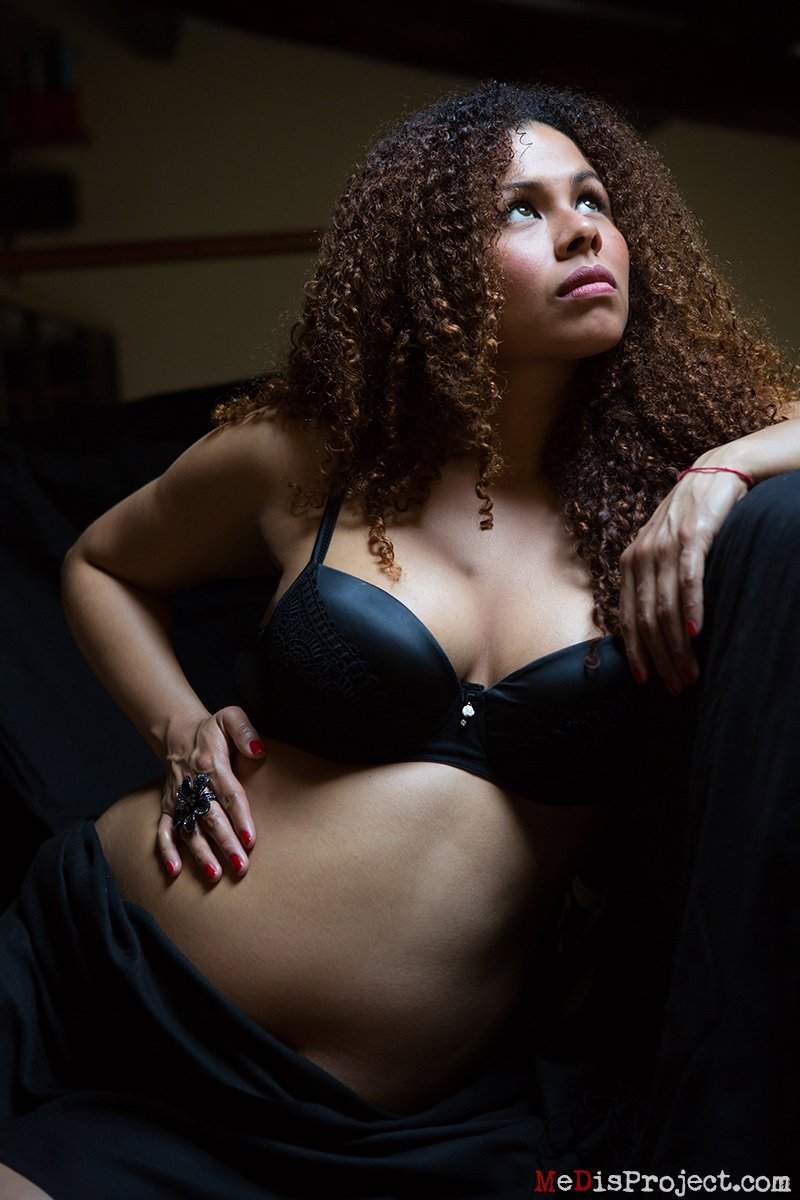 beautiful pregnant woman's portrait in black lingerie