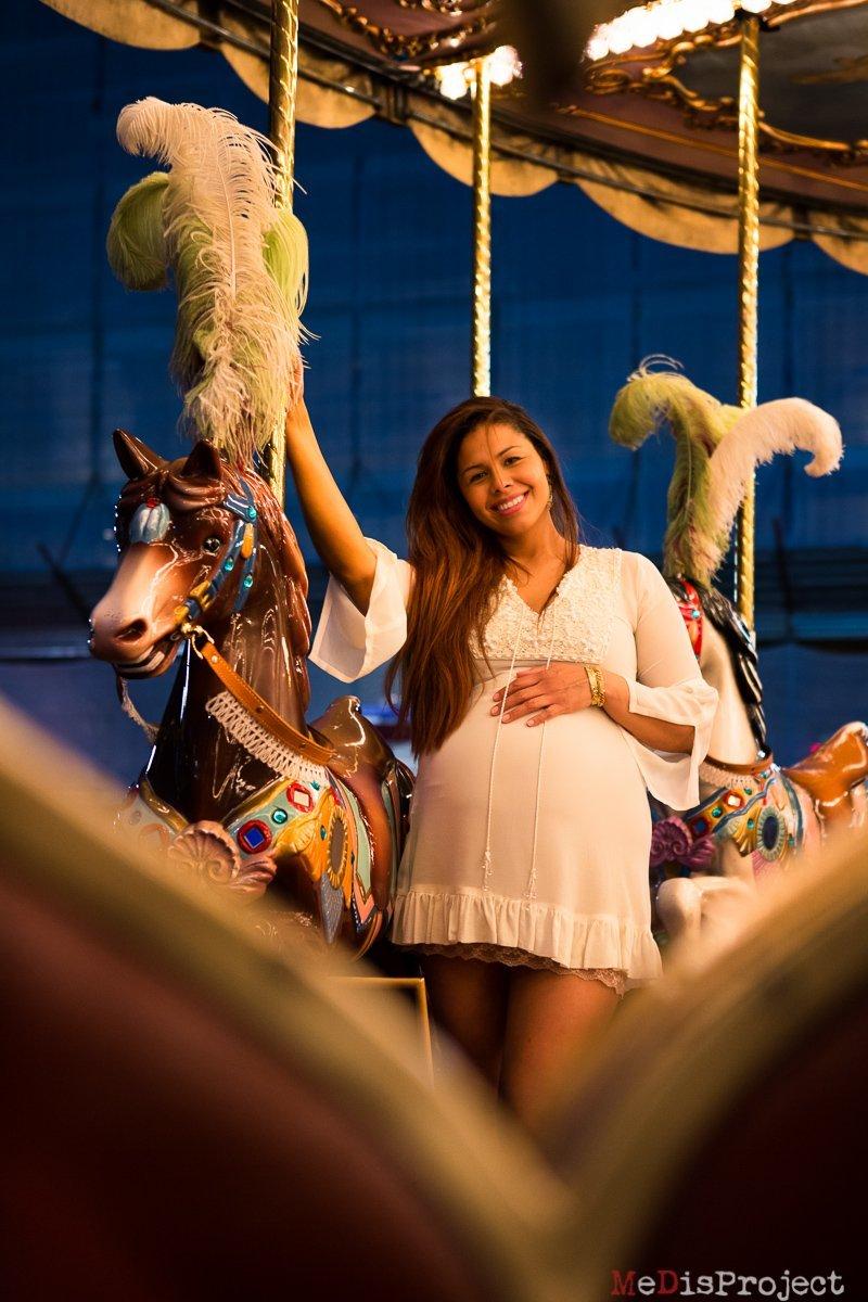pregnant woman posing on Piazza della Repubblica's carousel