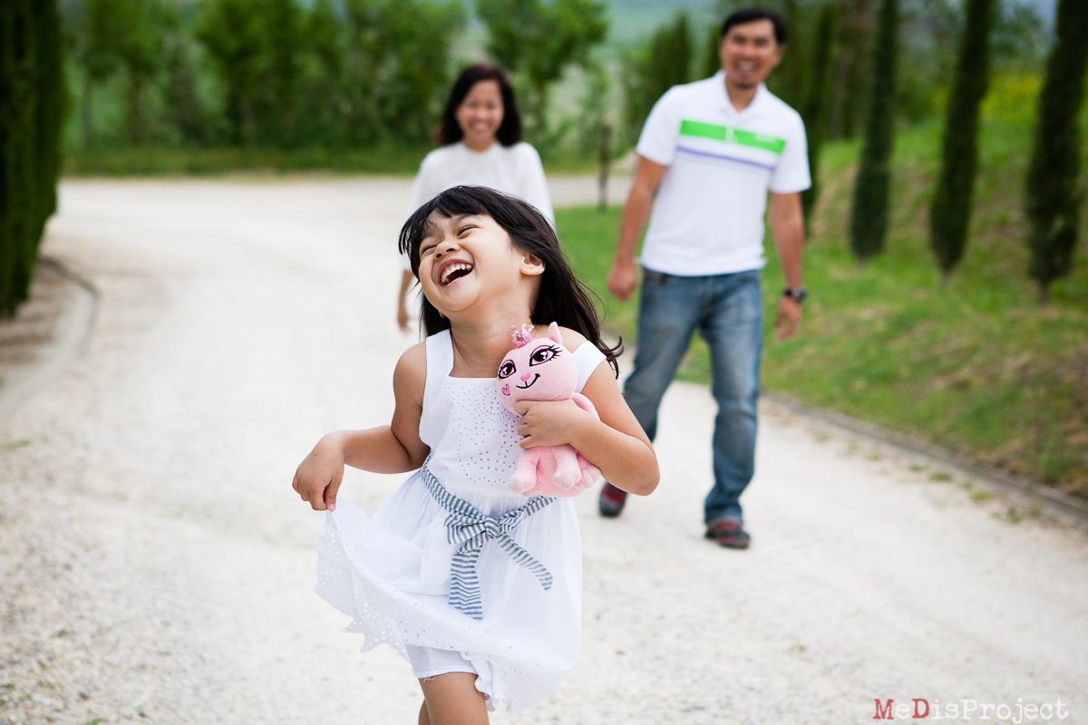 happy girl running with her pink doll