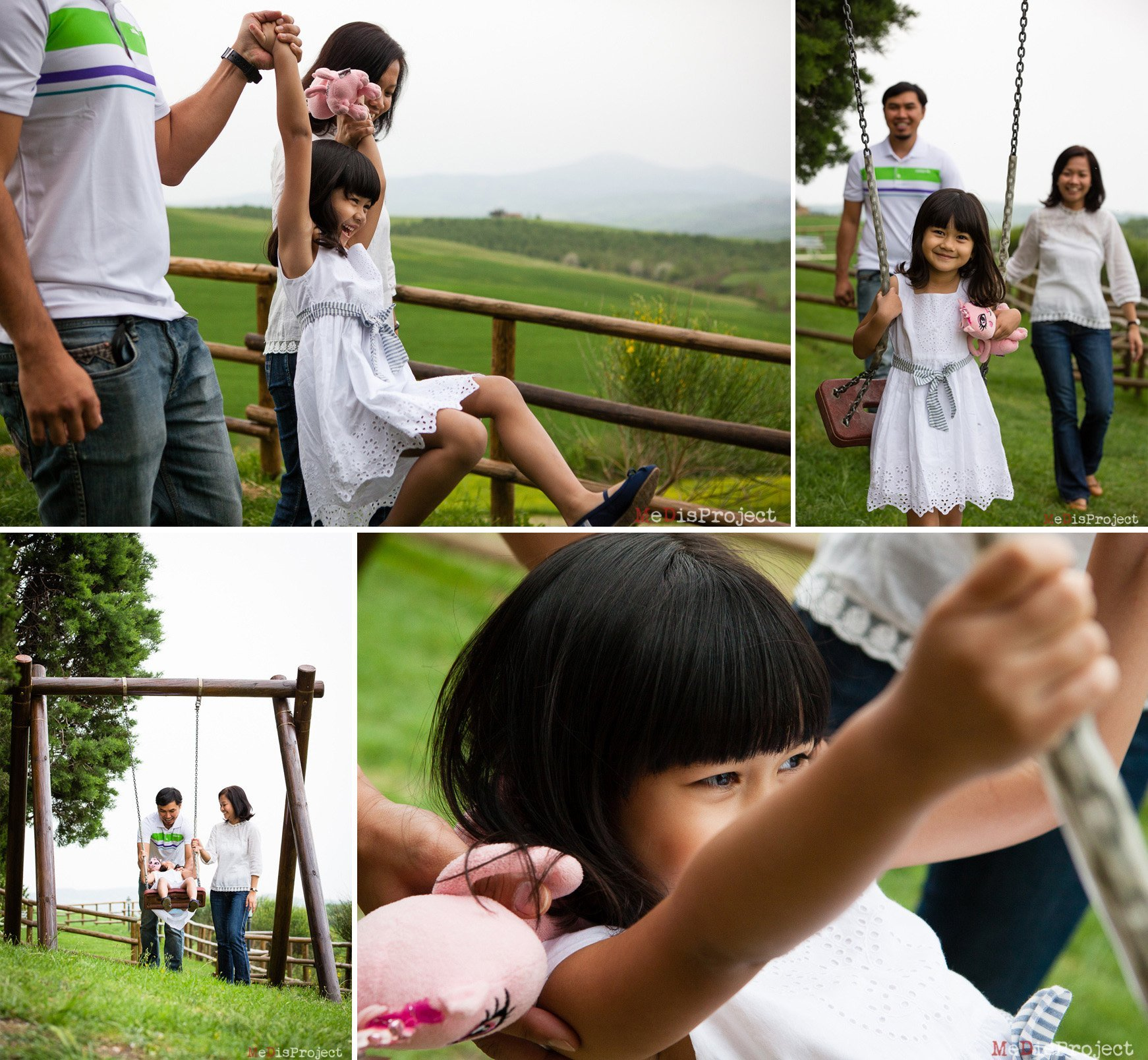 asian family portrait on a wooden swing