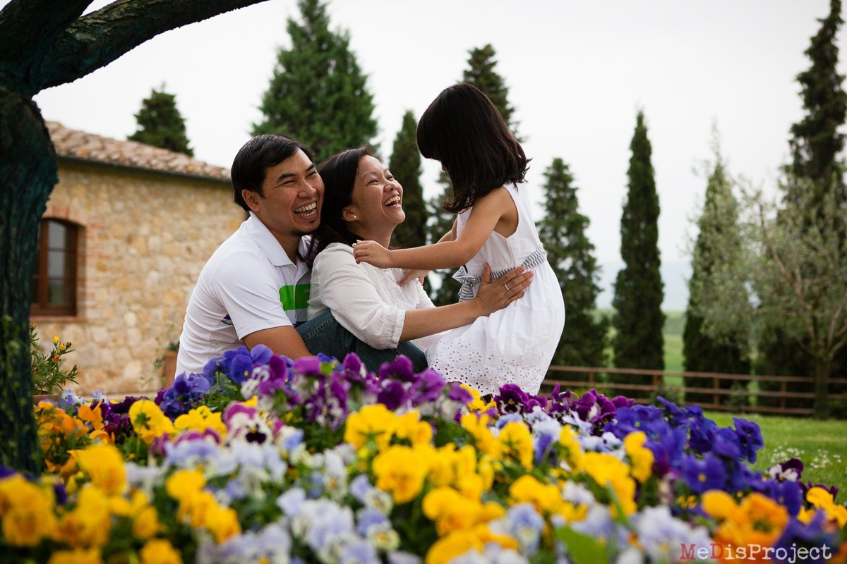 Singaporean family portrait with colorful flowers