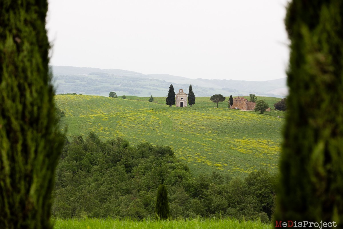 Vitaleta chapel pops out the green fields of Val d'Orcia