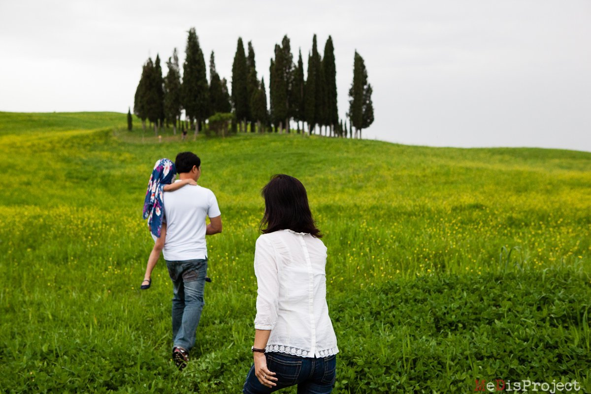 Singaporean family portrait under the cypresses of San Quirico