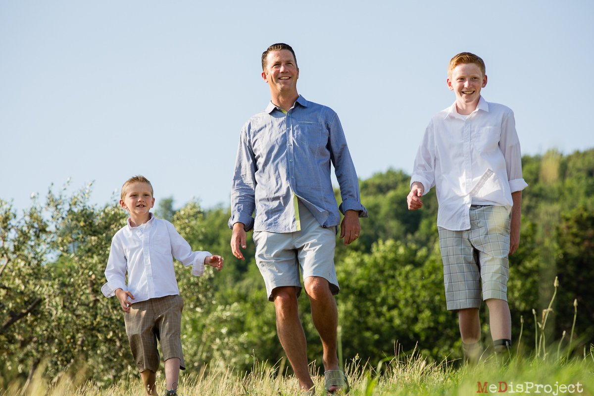 father and sons in tuscany