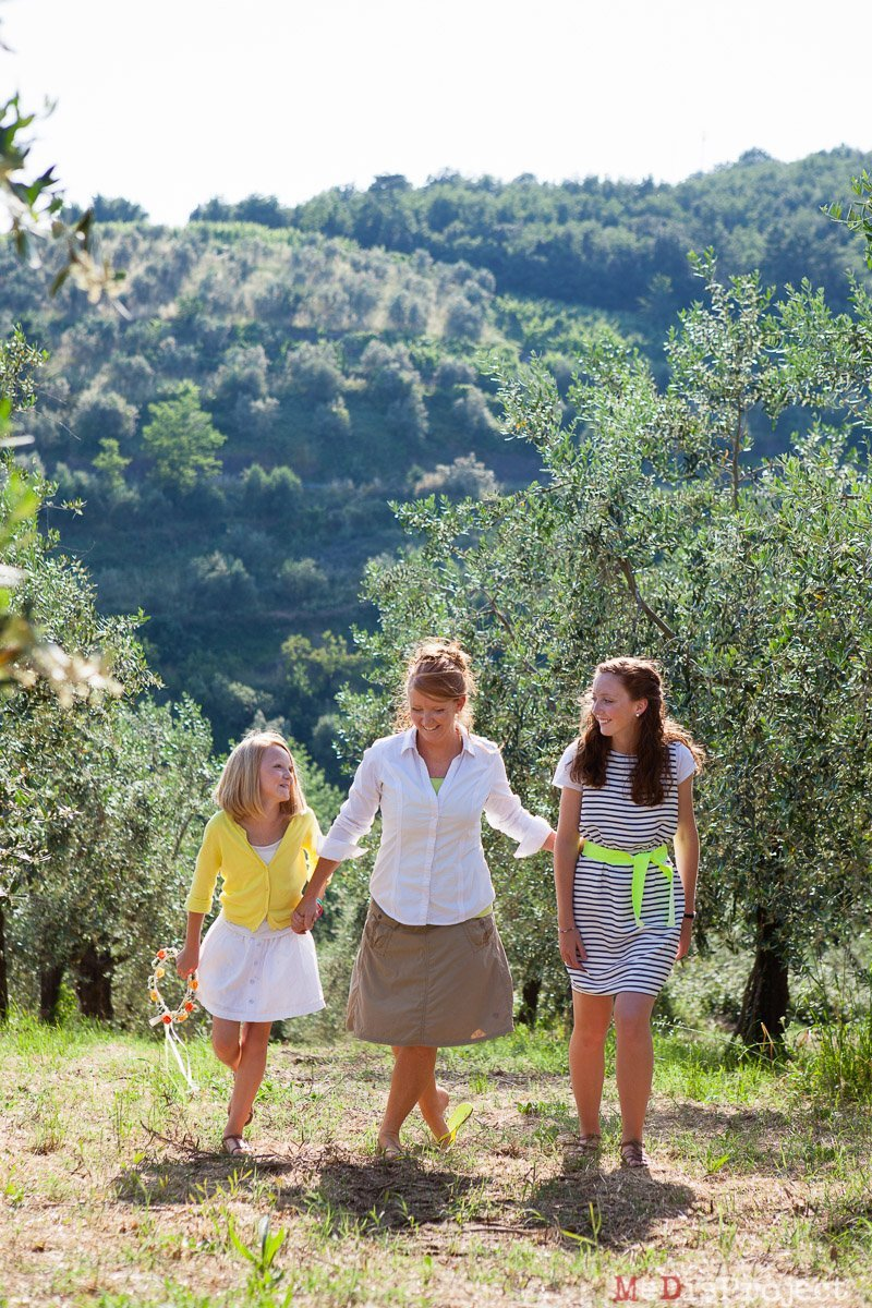 mother and daughters in tuscany