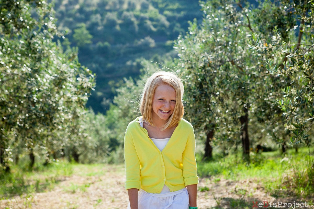 little girl's portrait in the olive grove