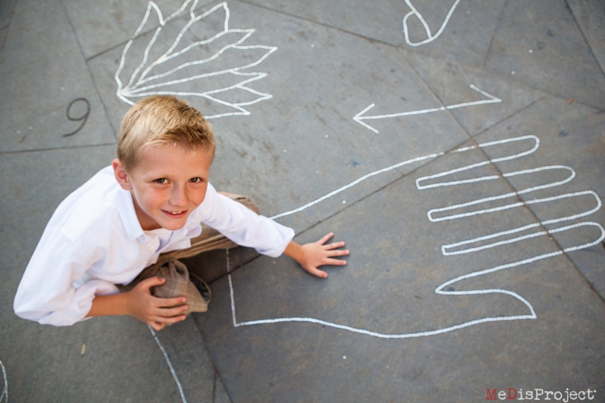 kid playing with a big hand on the floor