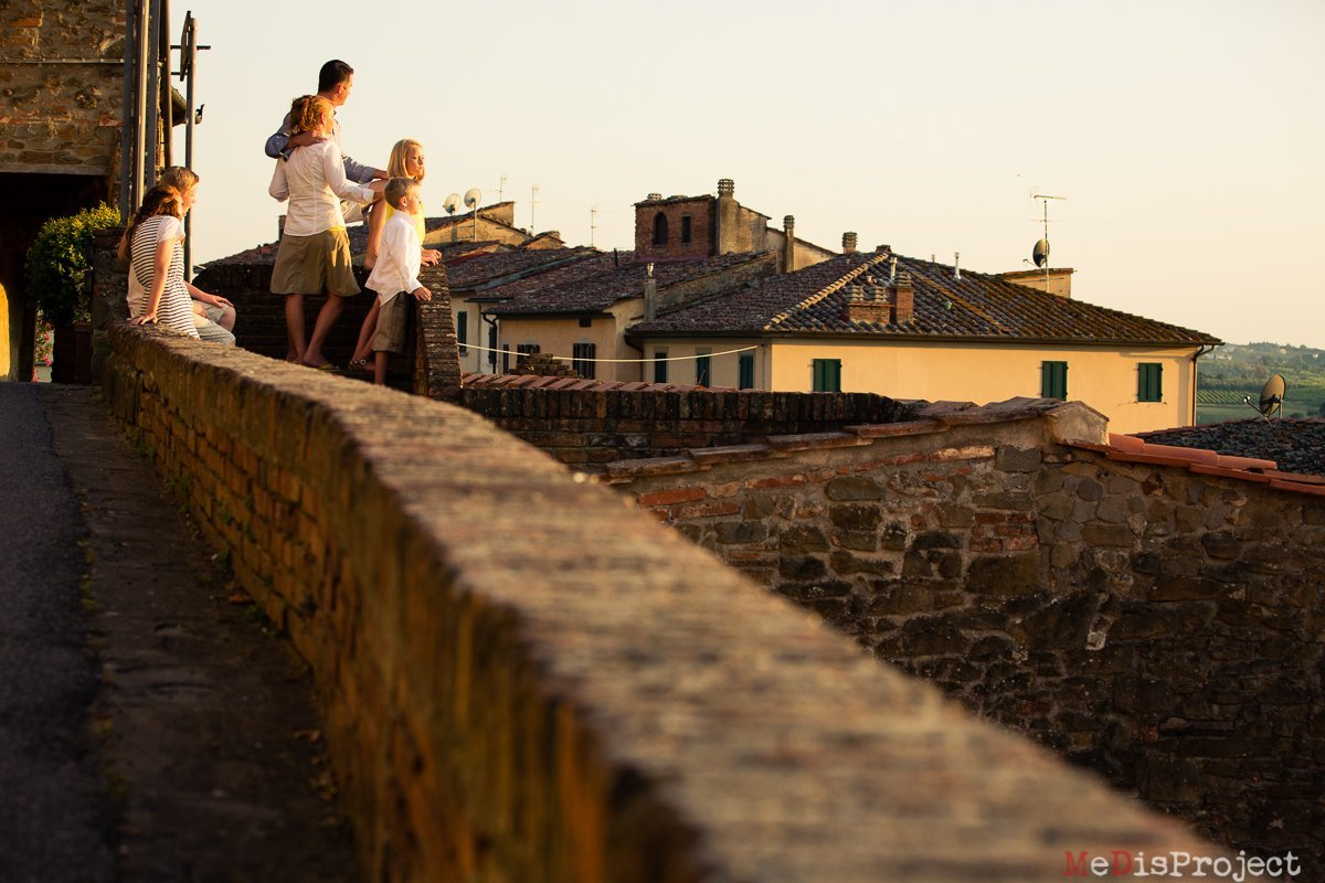 family of five watching sunset in vinci