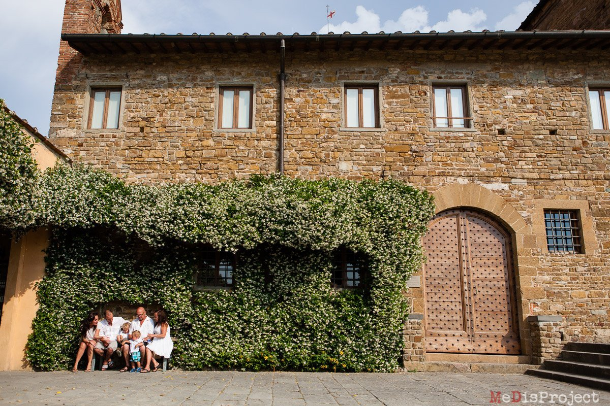 family portrait sitting on a bench in front of san miniato church in florence