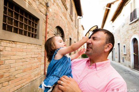 little girl hits her dad in the eye with his sunglasses