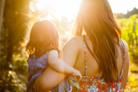 mother and daughter walking in the sunlight