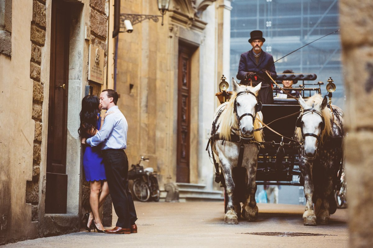 Couple kissing and old carriage in Florence Italy