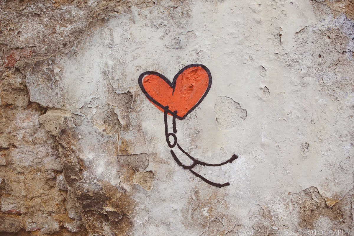 red heart graffiti on a wall in Florence city center