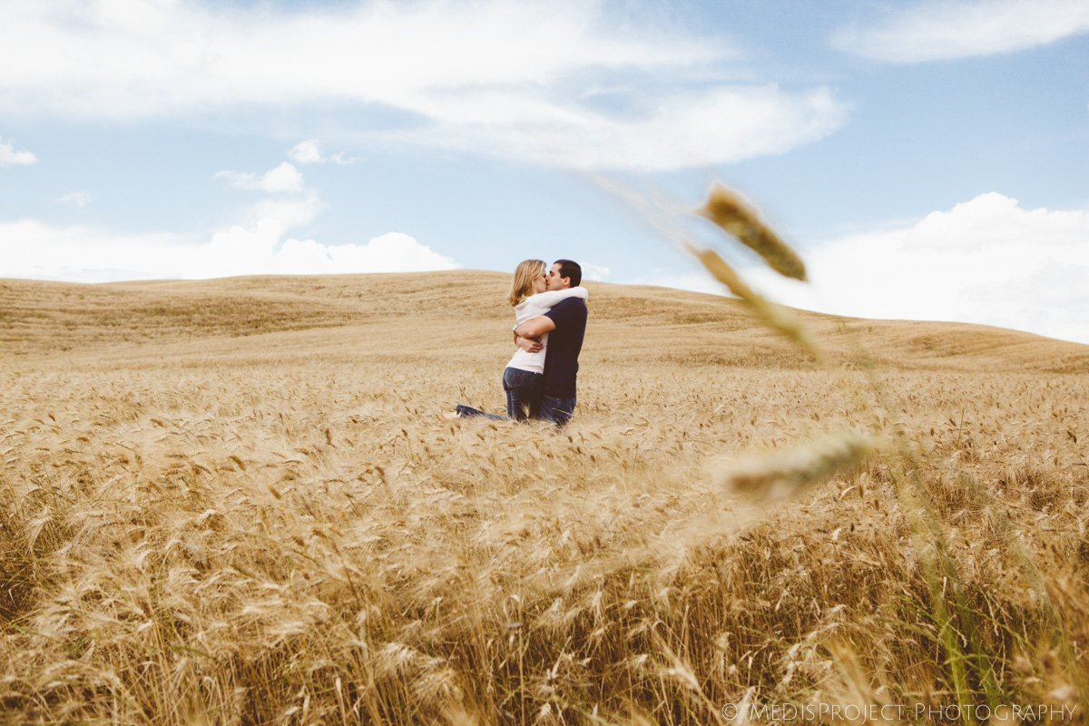 happy couple in the fields