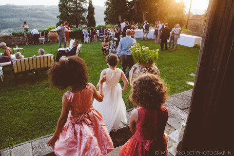 kids running at outdoor wedding reception