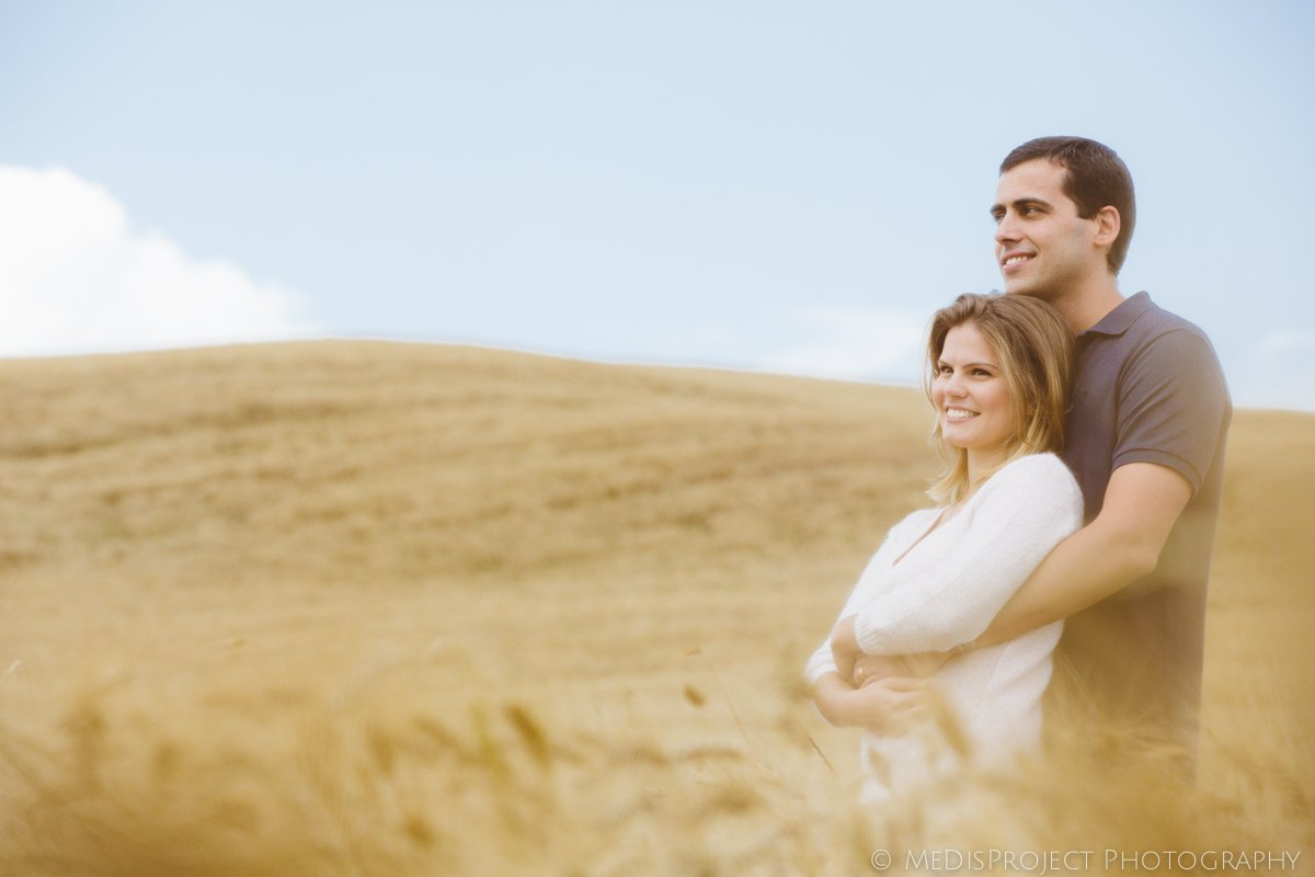 romantic couple hugging in a grain field