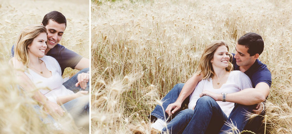couple sitting in a barley field
