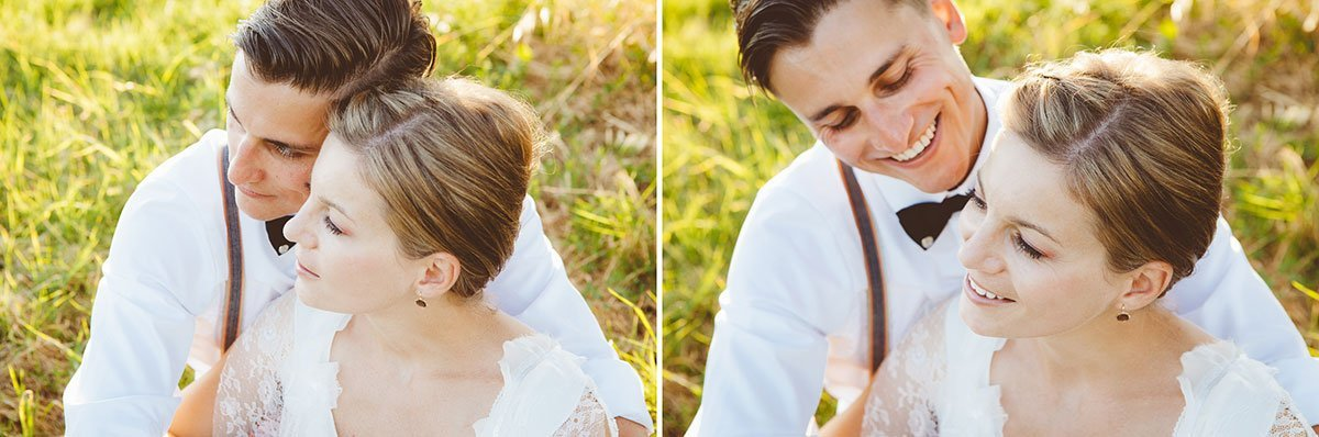 bride and groom sitting on a grass