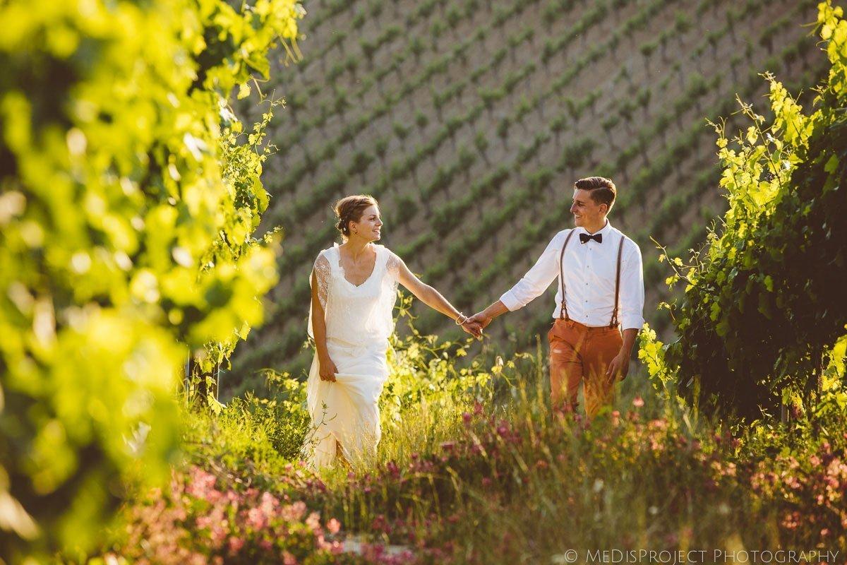 bride and groom having a walk in a vineyard