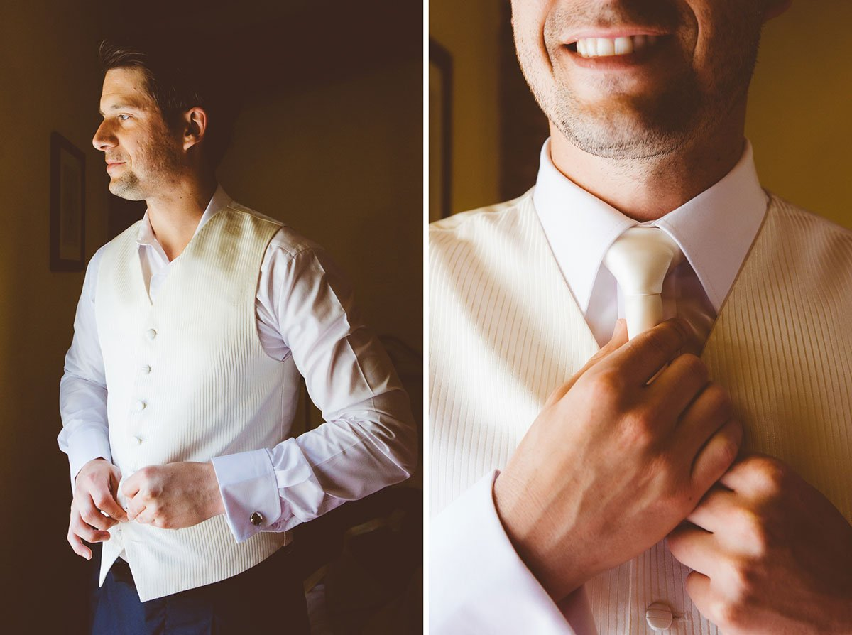 groom putting his vest and putting on his neck-tie
