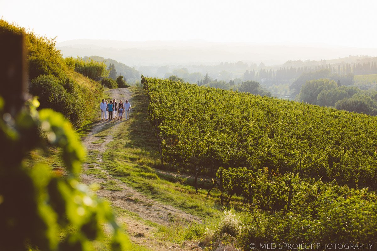 family in the tuscan vineyards