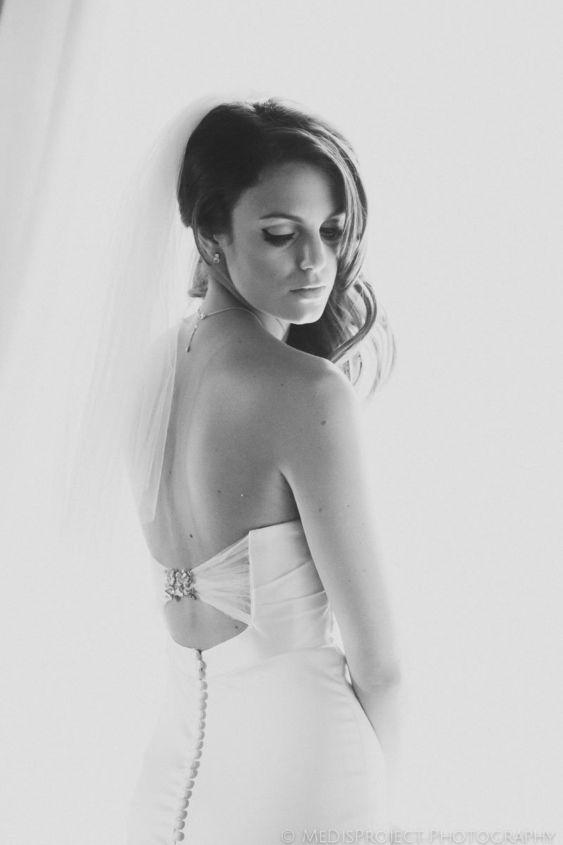 black and white bride showing her back