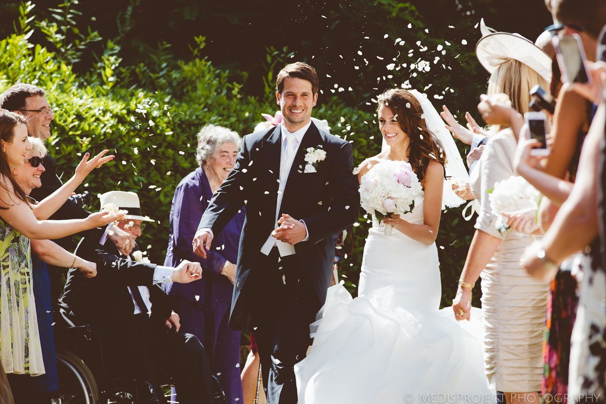 throwing petals to bride and groom