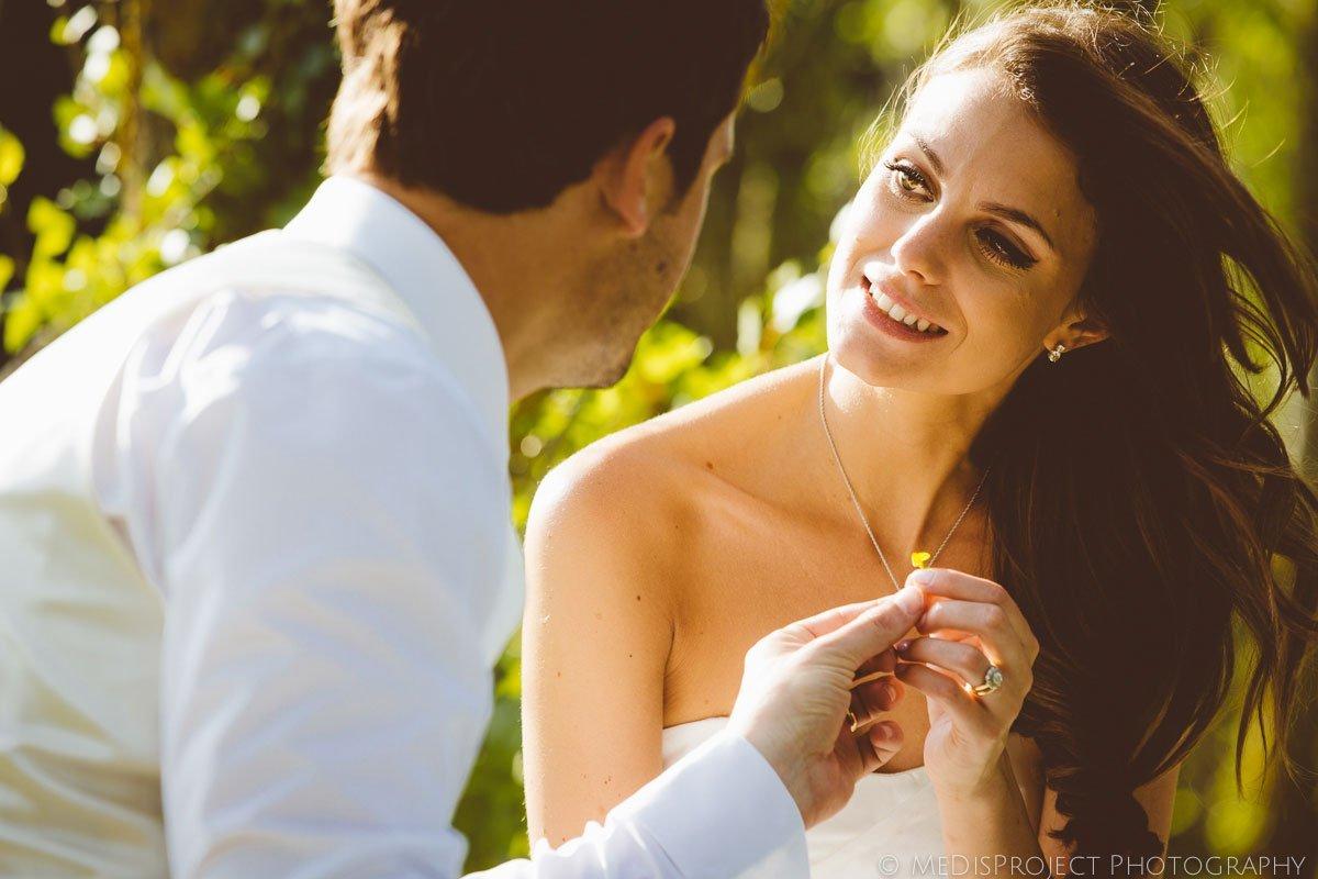little flower in bride's hands
