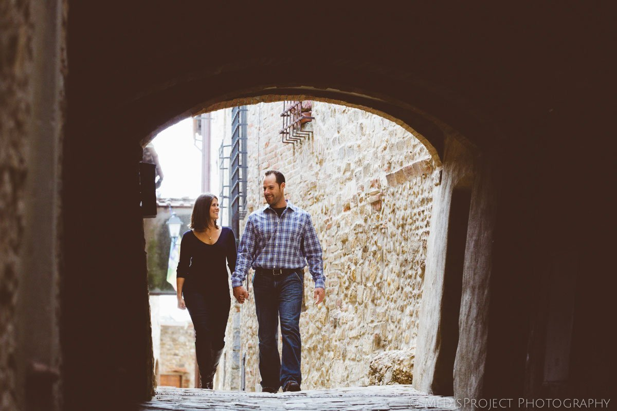 couple passing under an archway