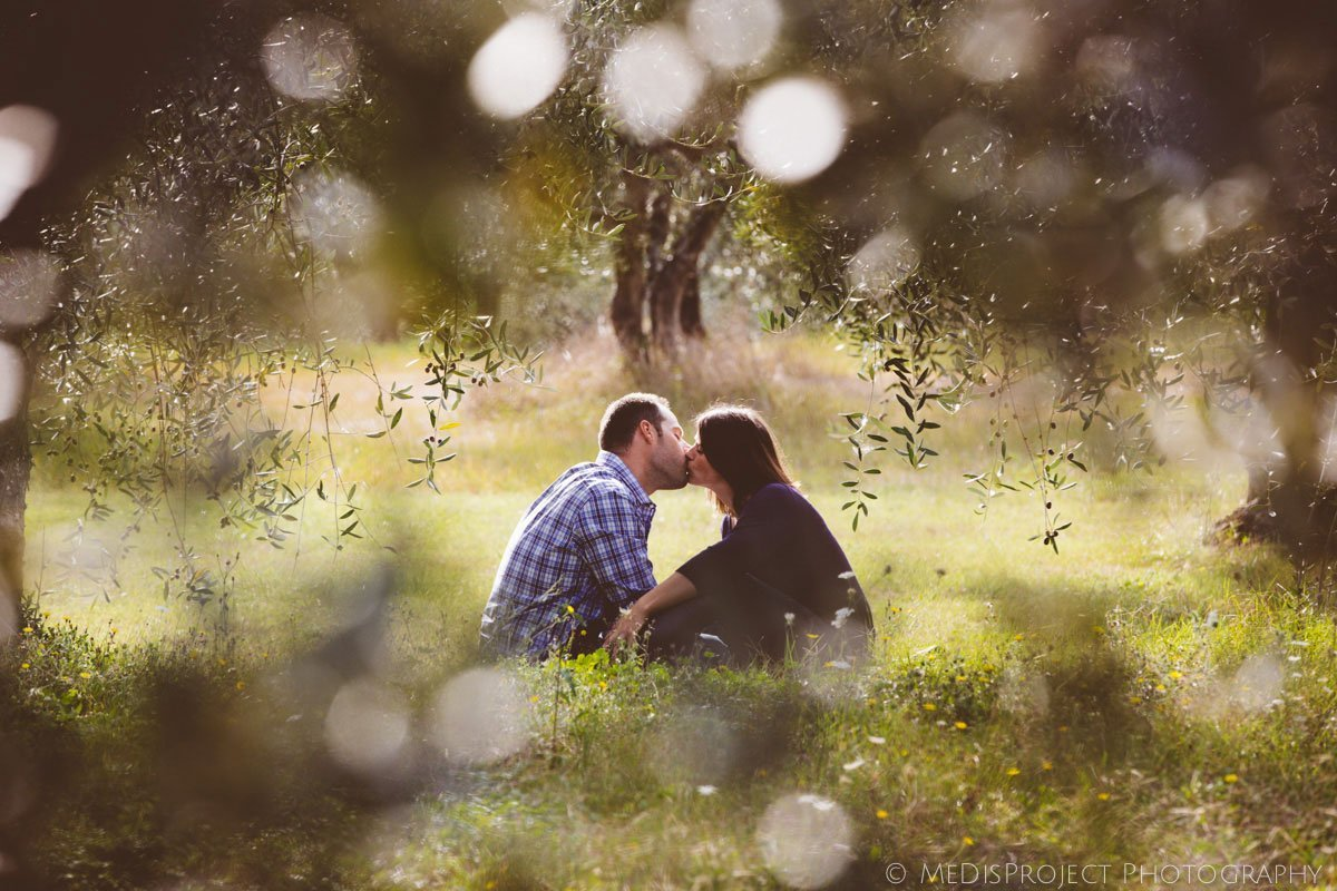 couple kissing in olive grove at fall