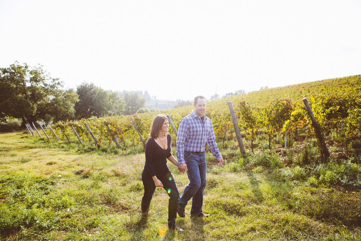 couple in the vineyards at fall
