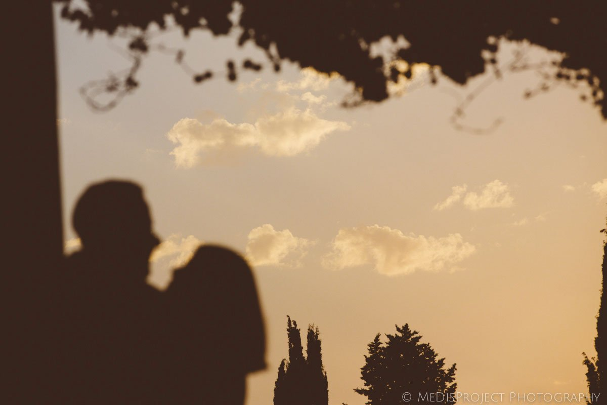cloud at sunset with silhouette of two lovers in Florence
