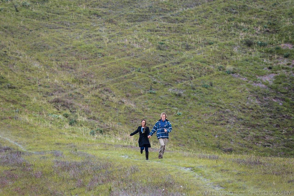 couple running on the hills surrounding certaldo