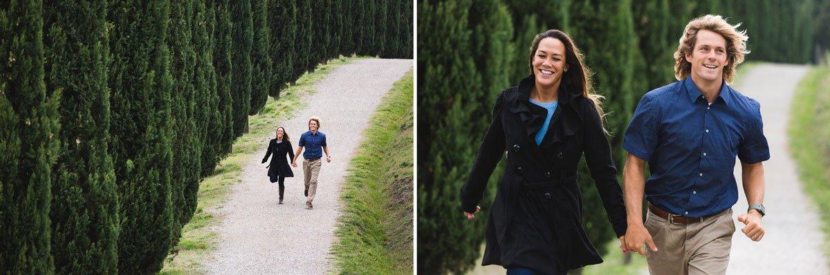 couple running throgh a cypress alley in certaldo alto