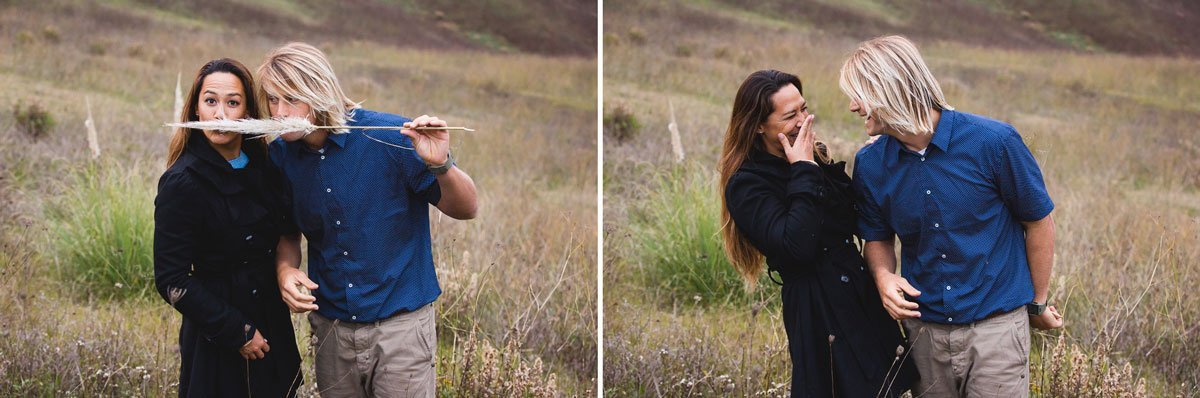 funny photo of a lovely couple playing around with hair grass