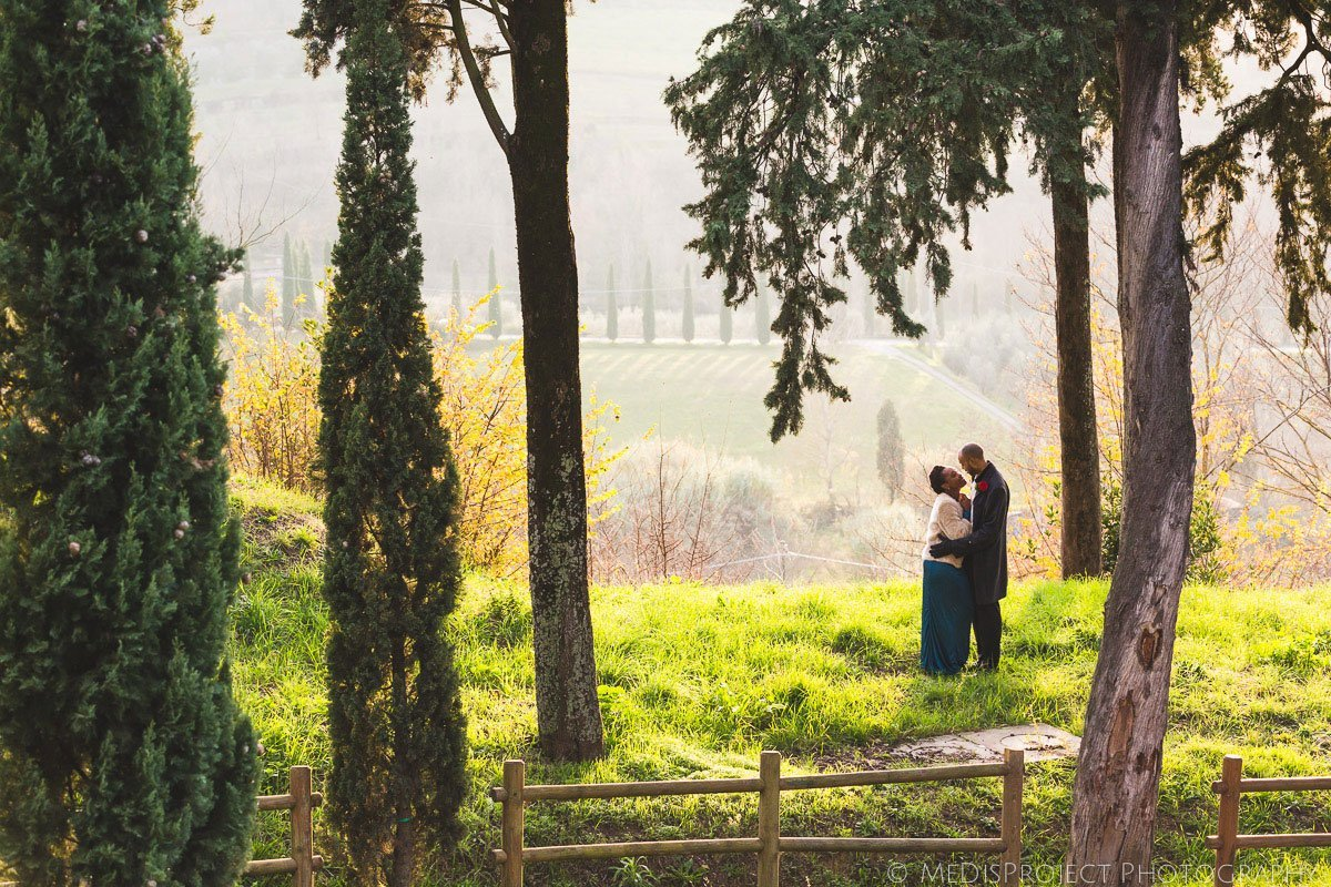 bride and groom in a green valley