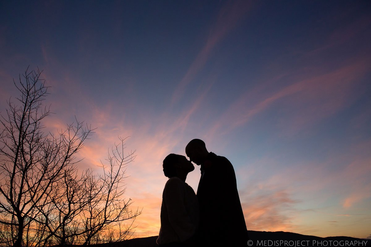 a couple kissing in the sunset