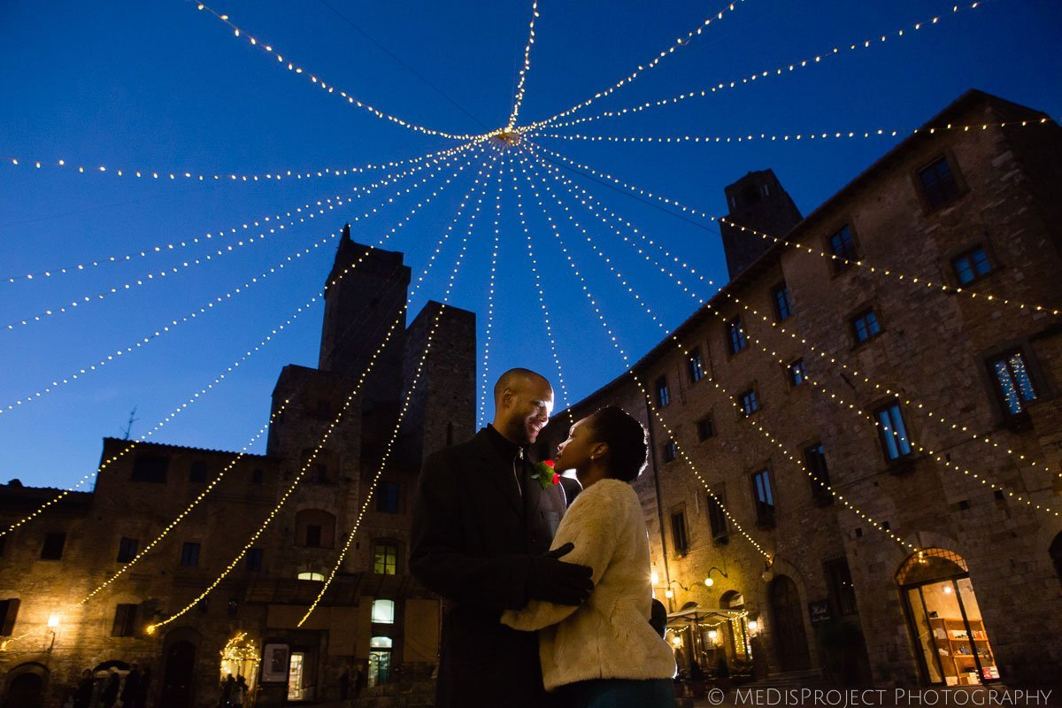 San Gimignano Winter Elopement photos with Christmas lights