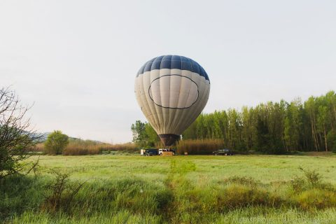 hot-air balloon about to take off over tuscan country