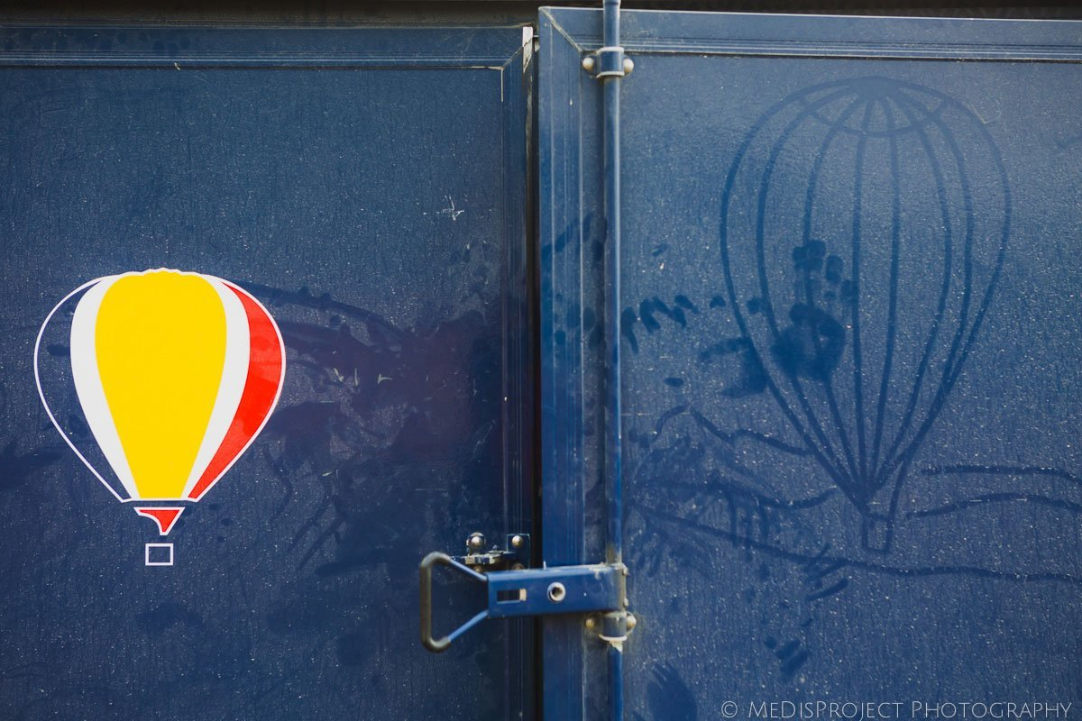 funny image of a hot-air balloon over dirty car