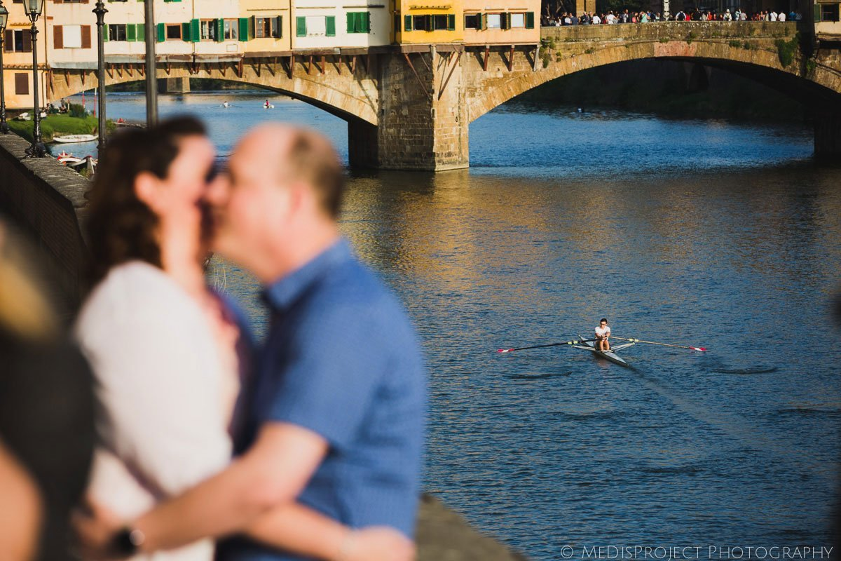 rowers on arno river in florence