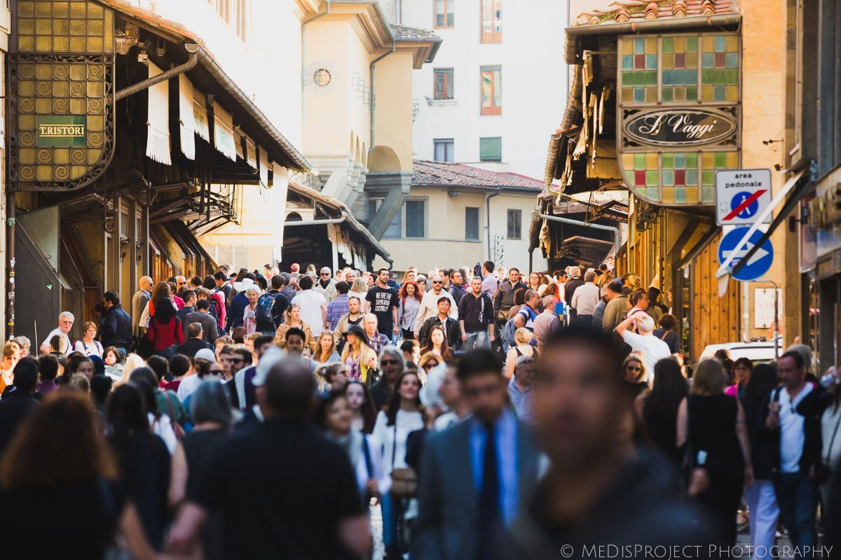 crowd crossing ponte vecchio in florence