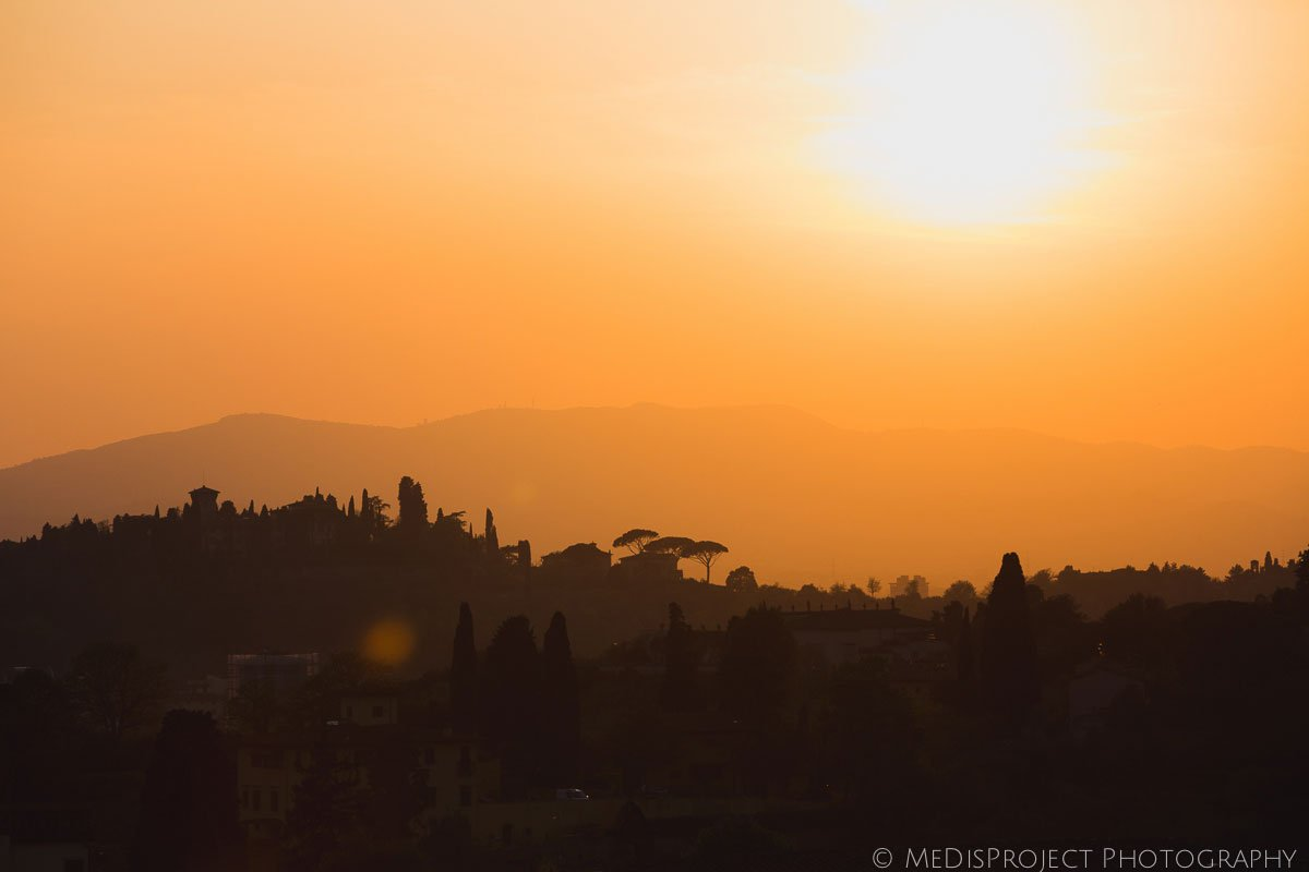view of tuscan hills around florence at sunset