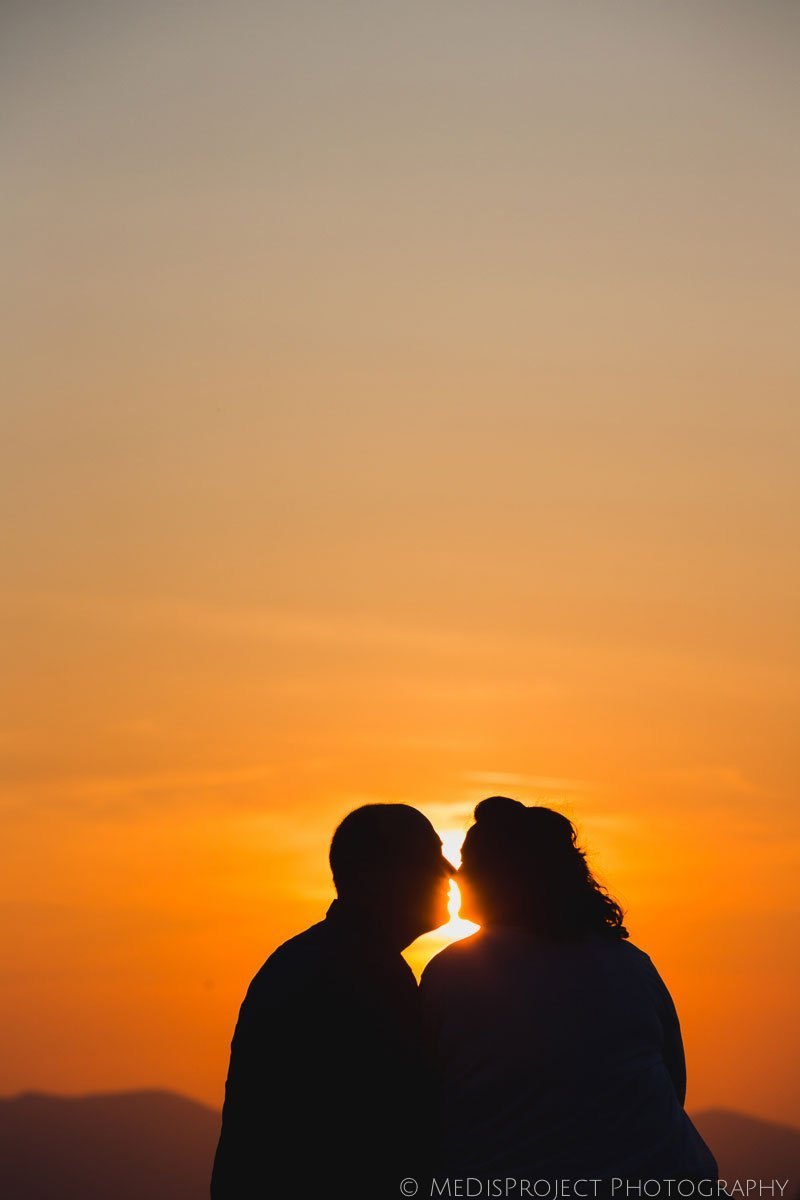 silhouette photo of a couple at sunset