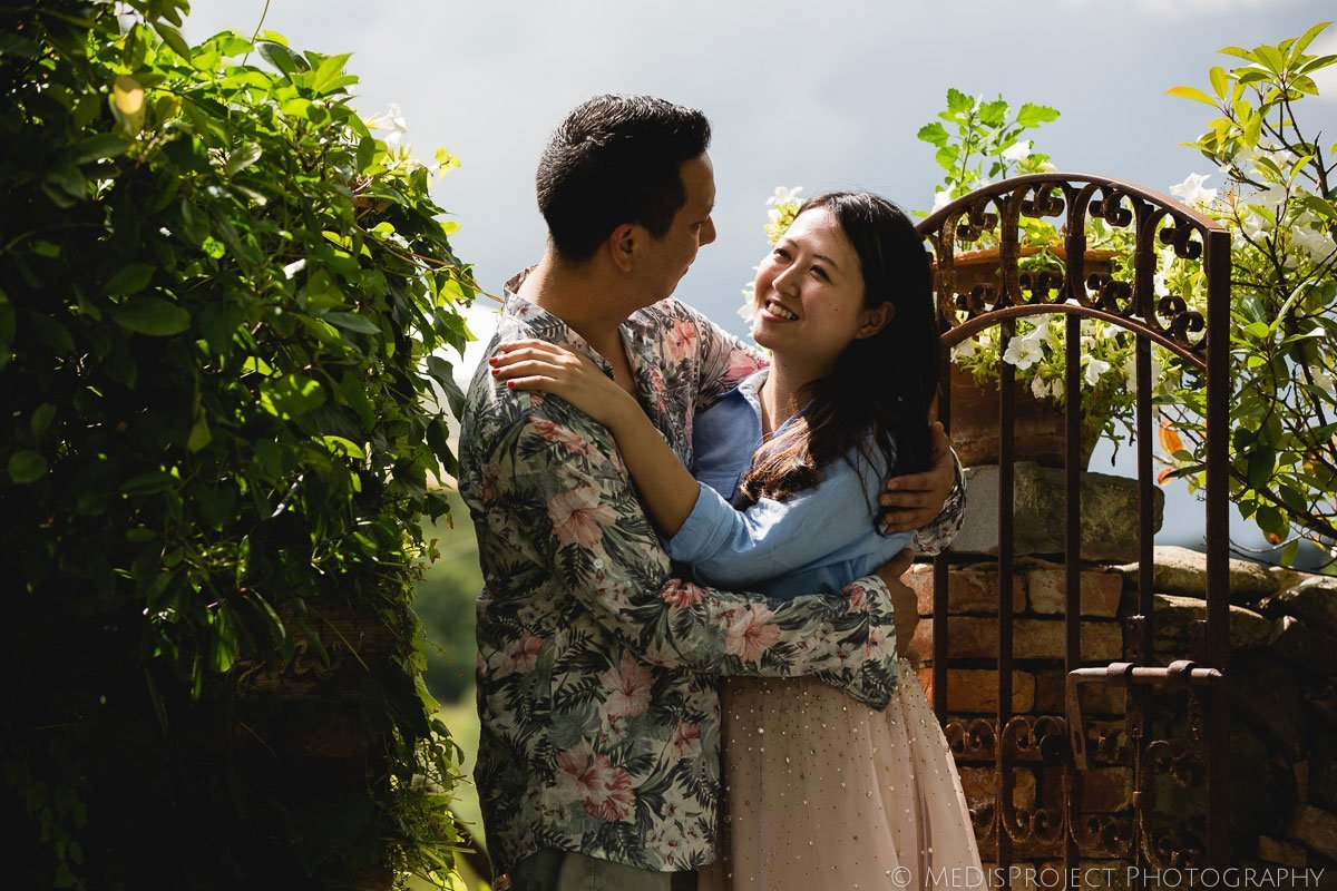 Chinese couple in Hotel Lupaia's blooming garden