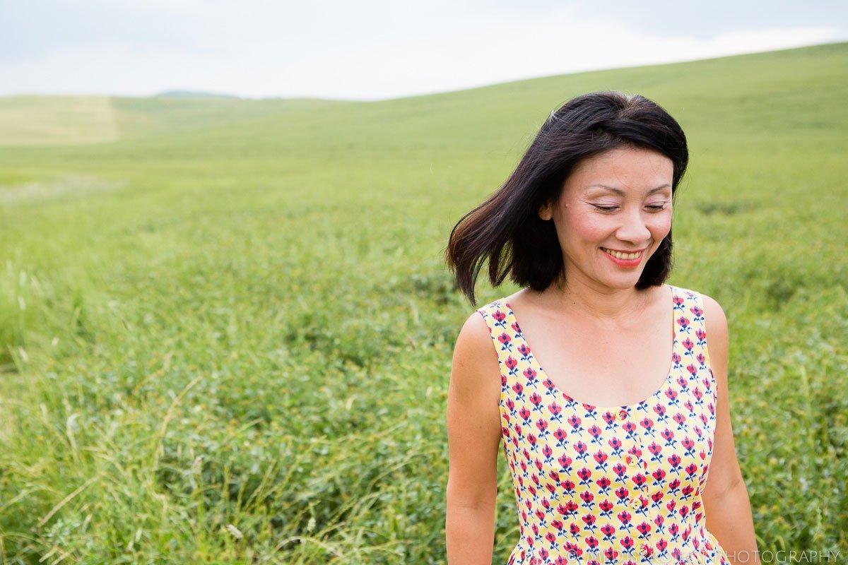 oriental woman walking in a green field