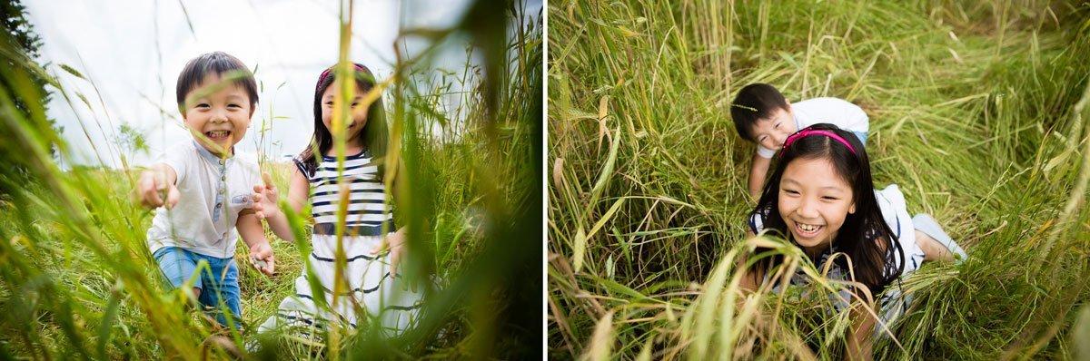 oriental kids playing in a wheat field