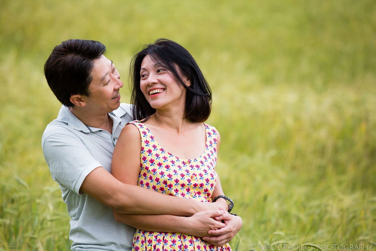 Oriental couple hugging and looking each other