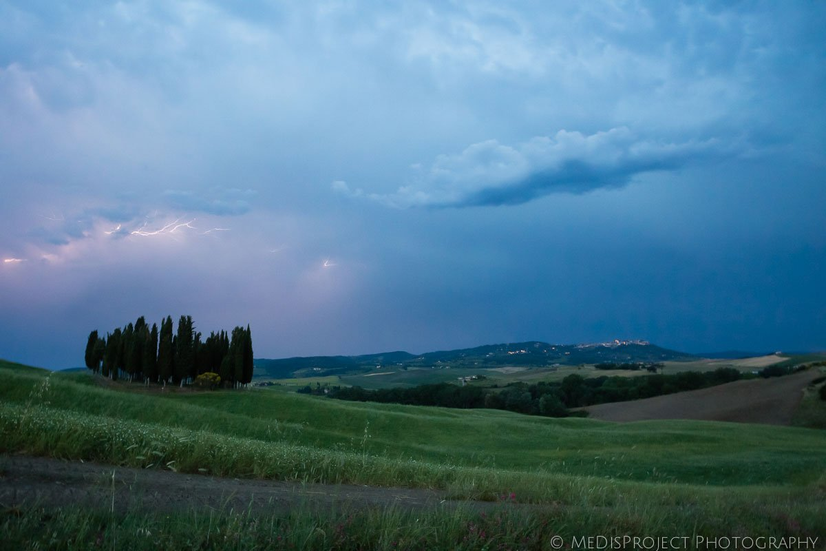 Summer storm over San Quirico's cypresses