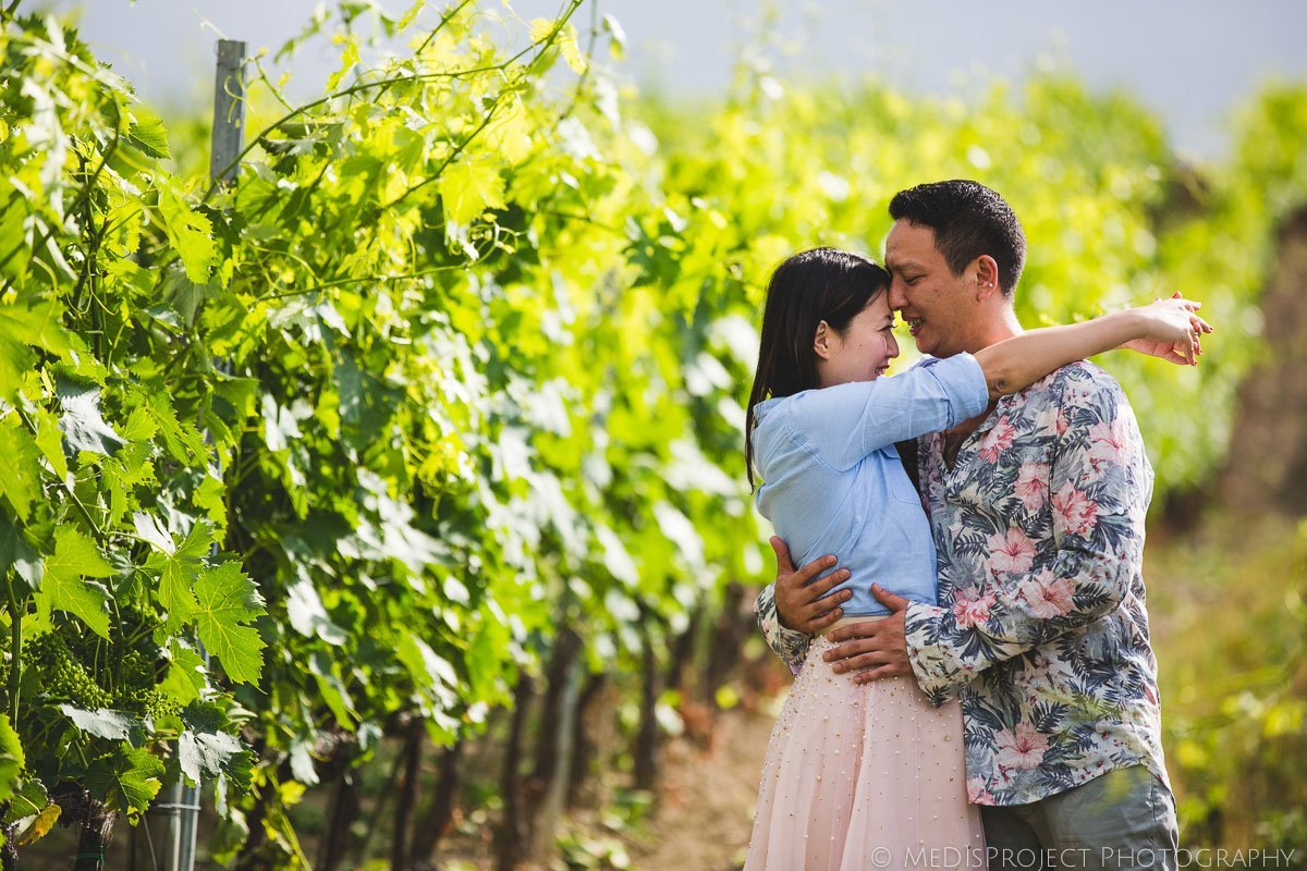 Chinese couple standing in a Tuscan vineyard